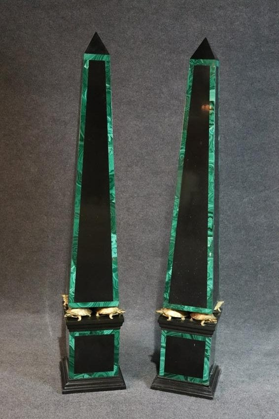 Black marble surfaces with malachite inlays. Each one sits atop of gilt bronze turtles and has matching bases.