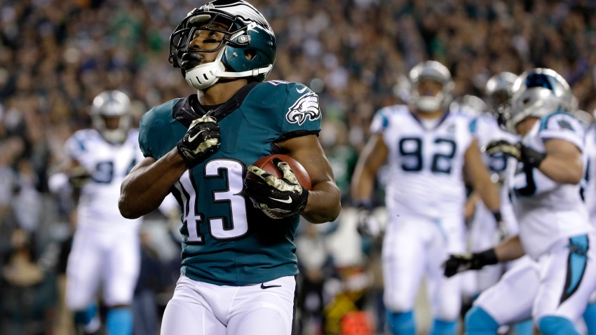Philadelphia Eagles' Darren Sproles reacts after scoring a touchdown during the first half of an NFL football game against the Carolina Panthers