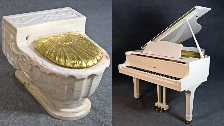 Sinatra's marble toilet with a gold lid and Sinatra's white baby grand piano.