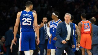 Philadelphia 76ers head coach Brett Brown reacts in front of guard Ben Simmons