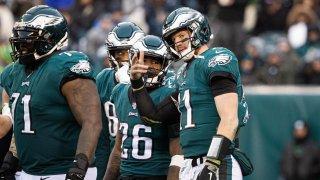Philadelphia, PA, USA; Philadelphia Eagles quarterback Carson Wentz (11) talks with running back Miles Sanders (26)
