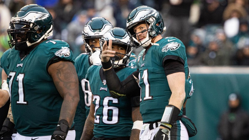 Philadelphia, PA, USA; Philadelphia Eagles quarterback Carson Wentz (11) talks with running back Miles Sanders (26)