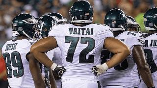 Halapoulivaati Vaitai huddles with his Eagles teammates