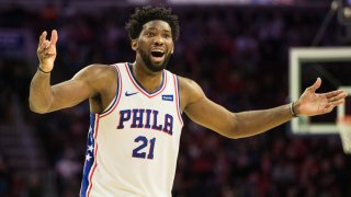Philadelphia 76ers center Joel Embiid (21) reacts to a foul call during the third quarter against the Detroit Pistons at Wells Fargo Center