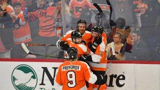 Philadelphia Flyers right wing Kevin Hayes (13) celebrates his short-handed goal with right wing Claude Giroux (28), defenseman Matt Niskanen (15) and defenseman Ivan Provorov (9)
