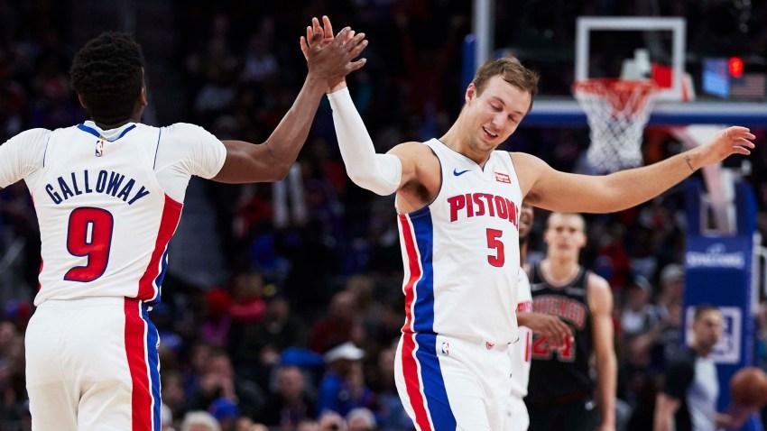 Detroit Pistons guard Langston Galloway (9) receives congratulations from guard Luke Kennard (5) after he makes a three point basket