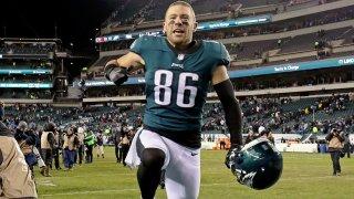 Zach Ertz of the Philadelphia Eagles takes of his helmet and celebrates.