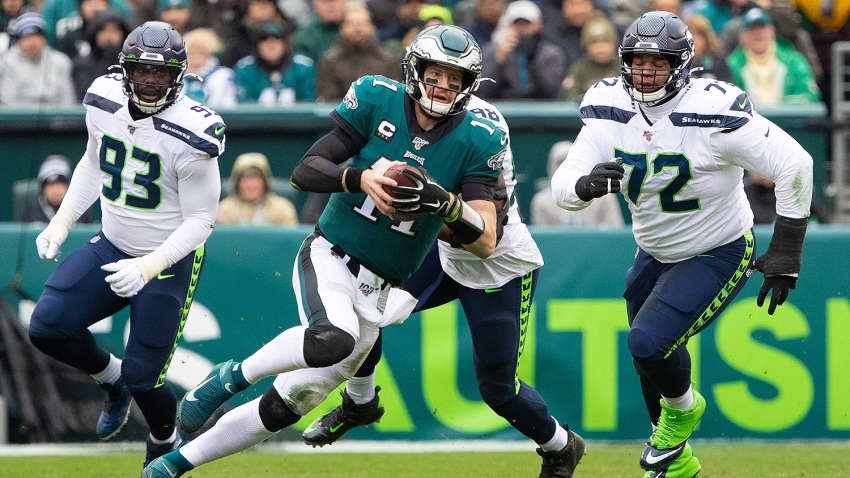 Philadelphia Eagles quarterback Carson Wentz (11) runs with the ball against the Seattle Seahawks at Lincoln Financial Field