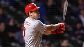 Philadelphia Phillies catcher J.T. Realmuto (10) hits a solo home run
