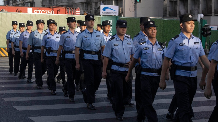 Chinese policemen prepare for duty around a neighborhood sealed off before the official closure of the United States Consulate in Chengdu in southwest China's Sichuan province, Monday, July 27, 2020.
