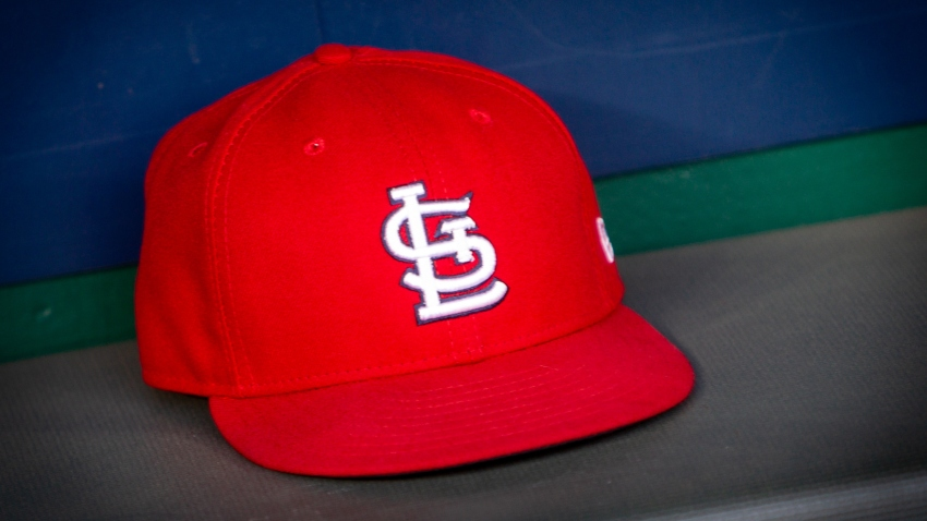 In this file photo, a St. Louis Cardinals hat sits in the dugout during the MLB interleague game against the Kansas City Royals on August 11, 2018 at Kauffman Stadium in Kansas City, Missouri.