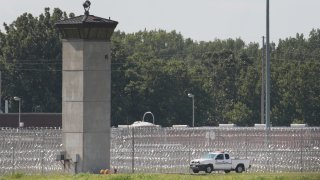 In this July 25, 2019, file photo, a truck is used to patrol the grounds of the Federal Correctional Complex Terre Haute in Terre Haute, Indiana.
