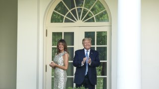 U.S. President Donald Trump and First Lady Melania Trump, left, exit after a Presidential Recognition Ceremony in the Rose Garden of the White House in Washington, D.C., U.S., on Friday, May 15, 2020.