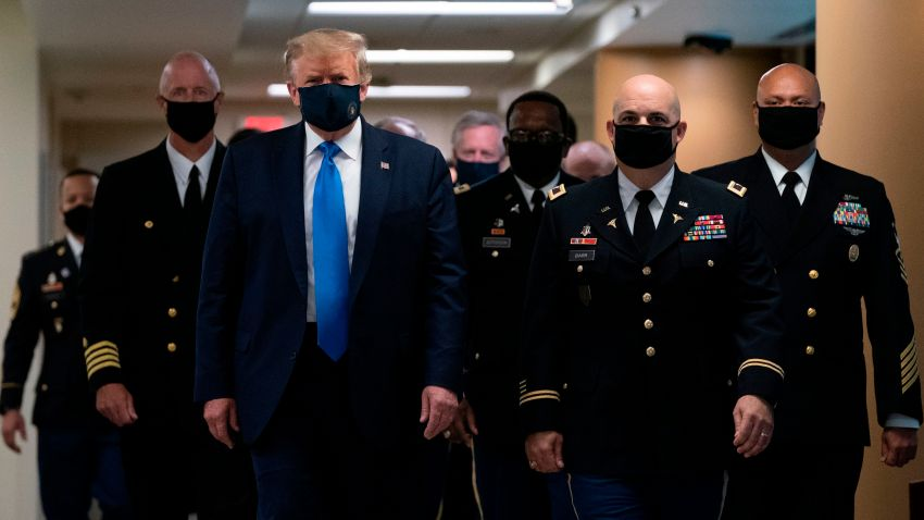 US President Donald Trump wears a mask