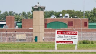 This July 15, 2020, file photo shows the entrance to the federal prison in Terre Haute, Indiana.