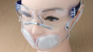 Researchers at MIT and Brigham and Women's Hospital have designed a silicone rubber face mask that they believe could stop viral particles as effectively as N95 masks. This image shows the mask on a mannequin head.