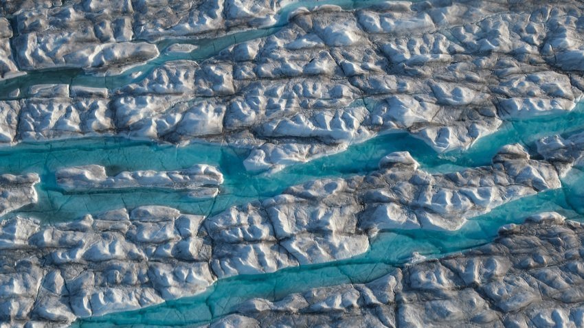 In this view from an airplane rivers of meltwater carve into the Greenland ice sheet near Sermeq Avangnardleq glacier on Aug. 4, 2019 near Ilulissat, Greenland.