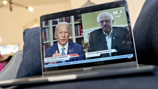 Former Vice President Joe Biden, presumptive Democratic presidential nominee, left, speaks as Senator Bernie Sanders, an Independent from Vermont, right, listens during a virtual event seen on an Apple Inc. laptop computer in Arlington, Virginia, U.S., on Monday, April 13, 2020.