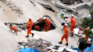 Rescuers search for survivors in the rubble of a collapsed hotel on March 8, 2020 in Quanzhou, Fujian Province of China