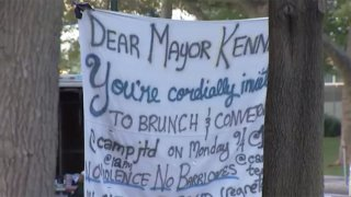 A banner inviting Mayor Kenney to brunch