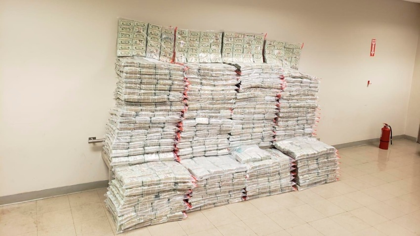This photo provided by the Drug Enforcement Administration Caribbean Division Office shows what it reports is 27 million dollars seized on Aug. 29 as part of the Inter-agency operation, at the US Customs and Border Protection, CBP, headquarters in San Juan, Puerto Rico, Monday, Aug. 31, 2020. CBP says the undeclared currency was found inside boxes bound to St. Thomas, US Virgin Islands.