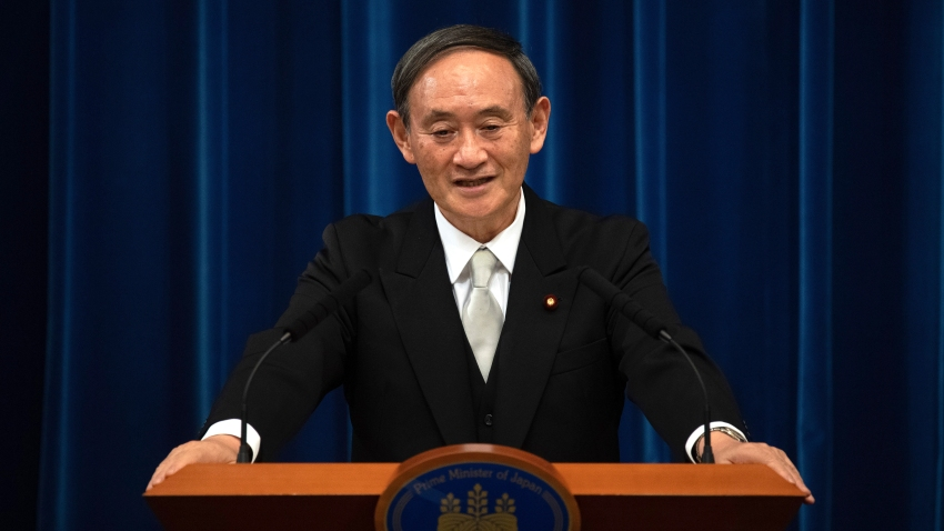 Japan's new Prime Minister Yoshihide Suga speaks during a press conference at the prime minister's official residence Wednesday, Sept. 16, 2020 in Tokyo, Japan. Suga, who was elected on Wednesday after gaining support for his pledges to pursue his predecessor Shinzo Abe's policies formed his 20-member Cabinet that retains many familiar faces, signaling continuation of Abe's line.