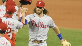 Bryce Harper of the Philadelphia Phillies celebrates a win after a baseball game against the Washington Nationals