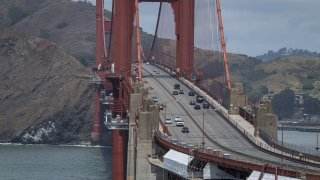 Traffic travels over the Golden Gate Bridge in San Francisco, California