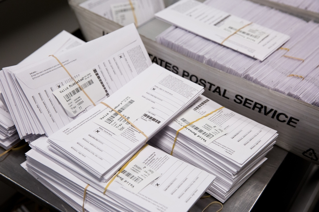 Sample voting ballots sit in a pile during a training on a new ballot sorting machine at the Board of Elections in Doylestown, Pennsylvania