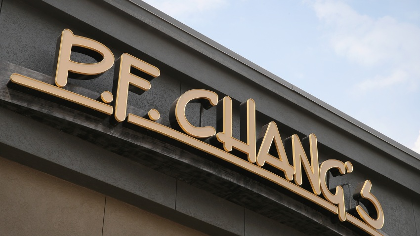 A sign hangs above a P.F. Chang's restaurant