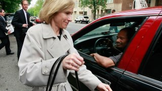 Connecticut prosecutor Nora R. Dannehy gets into a cab as she leaves the Law offices of Patton & Boggs after interviewing Karl Rove May 15, 2009 in Washington, DC. Rove was interviewed by Dannehy as part of a criminal investigation into the firing of U.S. attorneys during the Bush Administration.