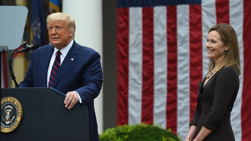US President Donald Trump announces his US Supreme Court nominee, Judge Amy Coney Barrett (R), in the Rose Garden of the White House in Washington, DC on September 26, 2020. - Barrett, if confirmed by the US Senate, will replace Justice Ruth Bader Ginsburg, who died on September 18.