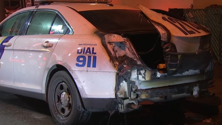The trunk of a Philadelphia Police Department cruiser is blackened after catching fire in a blaze that investigators called suspicious.