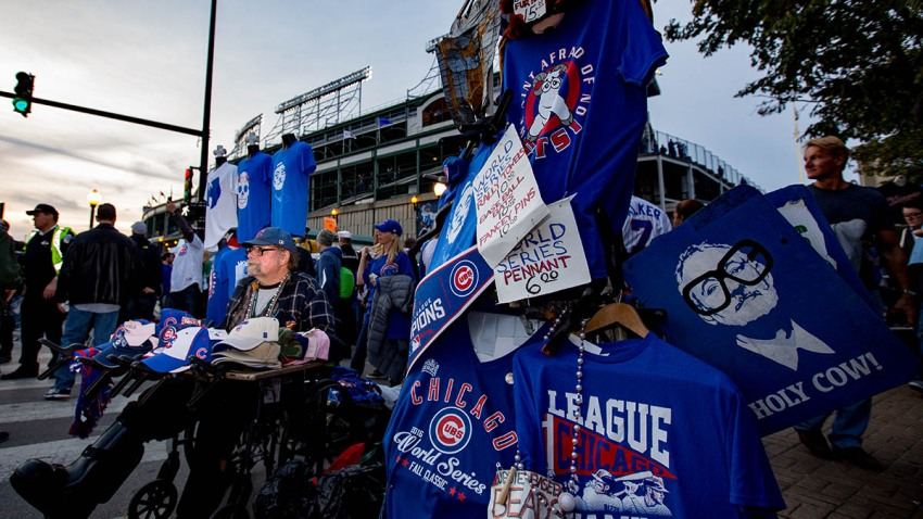 A man sells t-shirts in Wrigleyville ahead of Game Three of the 2016 World Series between the Chicago Cubs and the Cleveland Indians at Wrigley Field, Oct. 28, 2016, in Chicago.