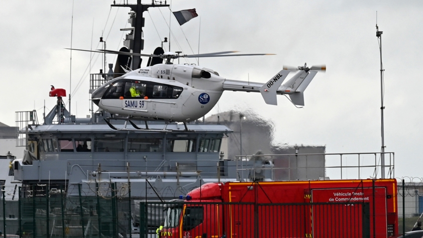 A French rescue helicopter lands close to a rescue vessel