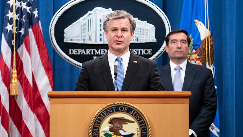 FBI Director Christopher Wray speaks during a virtual news conference at the Department of Justice, Oct. 28, 2020, in Washington, as Assistant Attorney General for National Security John Demers looks on.