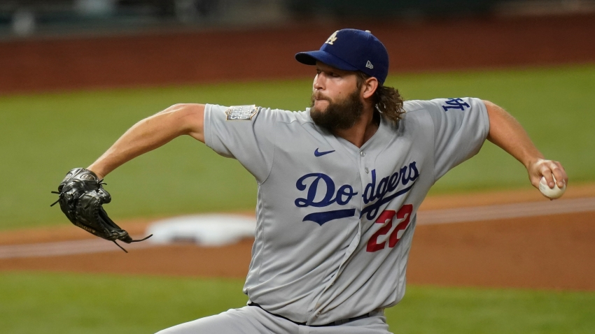 Los Angeles Dodgers starting pitcher Clayton Kershaw throws against the Tampa Bay Rays during the first inning in Game 5 of the baseball World Series Sunday, Oct. 25, 2020, in Arlington, Texas.