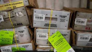 Pallets filled with Washington and Oregon mail-in ballots