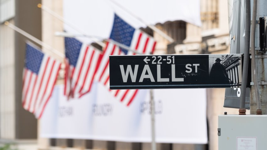 A view of the Wall Street street sign with the New York Stock Exchange as the city continues Phase 4 of re-opening following restrictions imposed to slow the spread of coronavirus on September 30, 2020 in New York City.