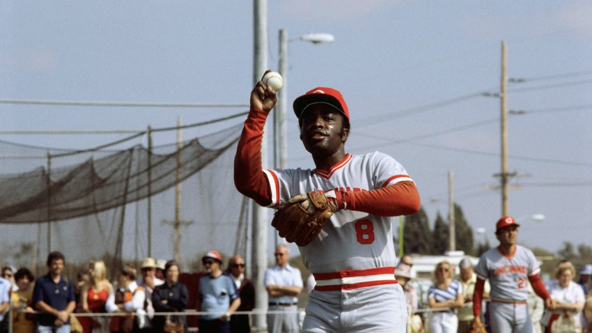 Cincinnati Reds' second baseman Joe Morgan prepares to throw the ball as fans watch from the sidelines, 1978.
