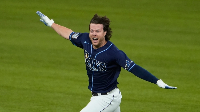 Tampa Bay Rays' Brett Phillips (14) celebrates the game winning hit against the Los Angeles Dodgers in Game 4 of the baseball World Series Saturday, Oct. 24, 2020, in Arlington, Texas. Rays defeated the Dodgers 8-7 to tie the series 2-2 games.