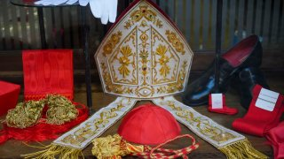 Cardinal clothing accessories are seen on display in the window of the Gammarelli clerical clothing shop, in Rome