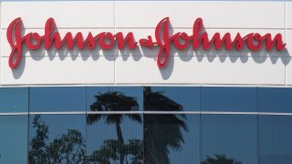 A sign on a building at the Johnson & Johnson campus shows their logo in Irvine, California on August 28, 2019.
