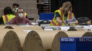 Election workers count ballots at the Philadelphia Convention Center on November