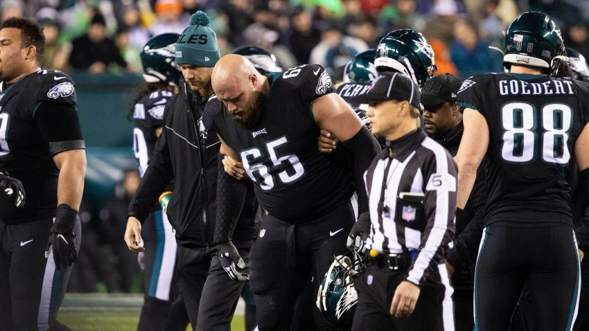 Philadelphia Eagles offensive tackle Lane Johnson (65) is helped off the field after an injury during the second quarter against the New York Giants at Lincoln Financial Field.