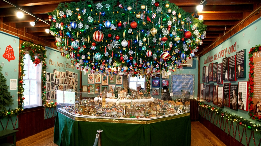 A Christmas display featuring ornaments and a model village