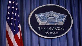 US flag and Pentagon logo
