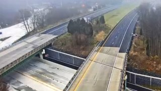 Northbound and southbound lanes of Interstate 95 are shown empty after a closure in Wilmington, Delaware.