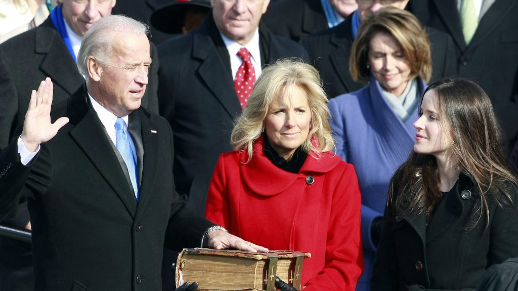 Vice President-elect Joseph Biden is sworn in during the inauguration of Barack Obama as the 44th President of the United States of America on the West Front of the Capitol Tuesday, Jan. 20, 2009 in Washington, Biden's wife, Jill, holds the Bible.