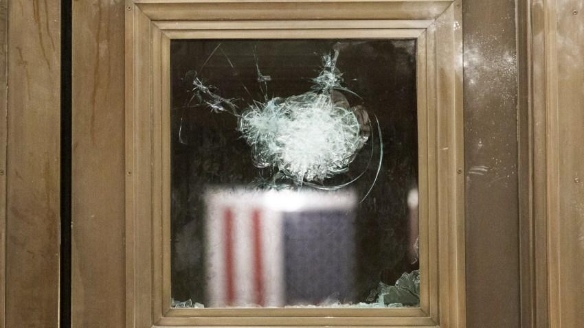A damaged door inside the U.S. Capital